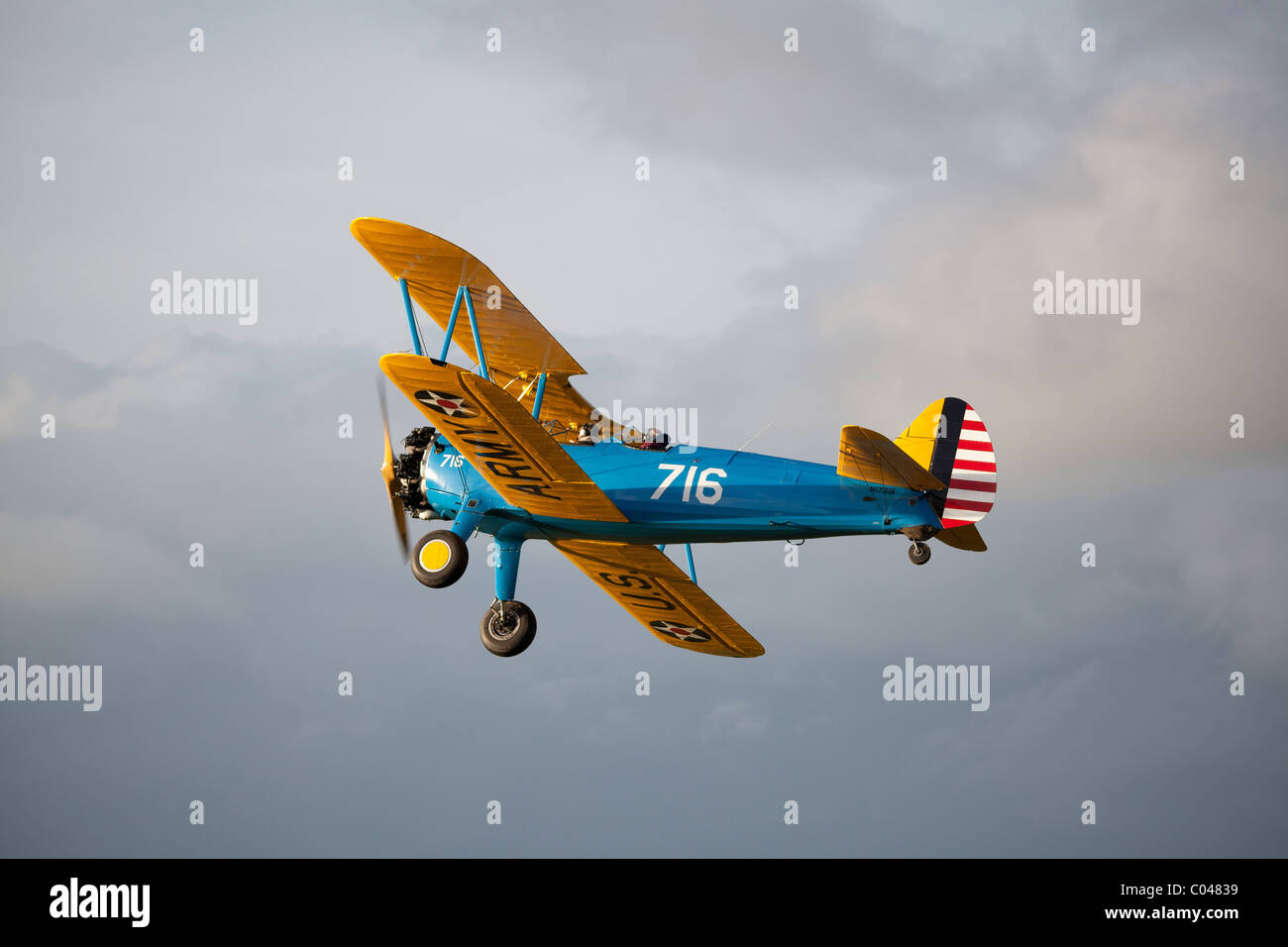 A vintage PT13-D Stearman biplane flying at Compton Abbas airfield in England - Stock Image