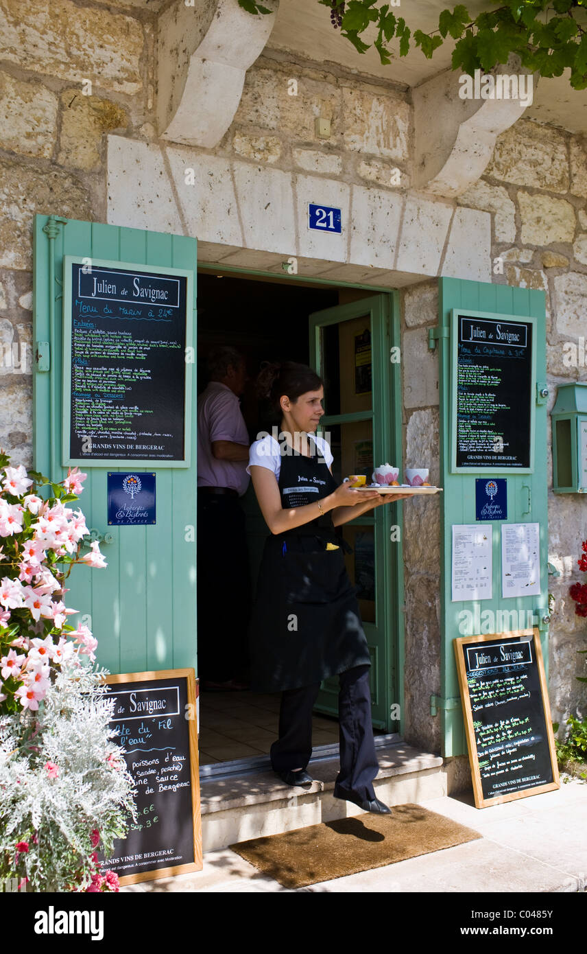 Waitress serving at French outdoor cafe in tourist town Brantome in the Northern Dordogne, France - Stock Image