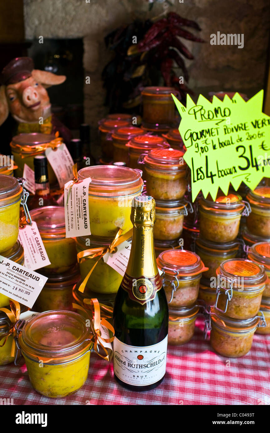 Foie Gras potted meats and Alfred Rothschild Brut champagne on sale Brantome, North Dordogne, France - Stock Image