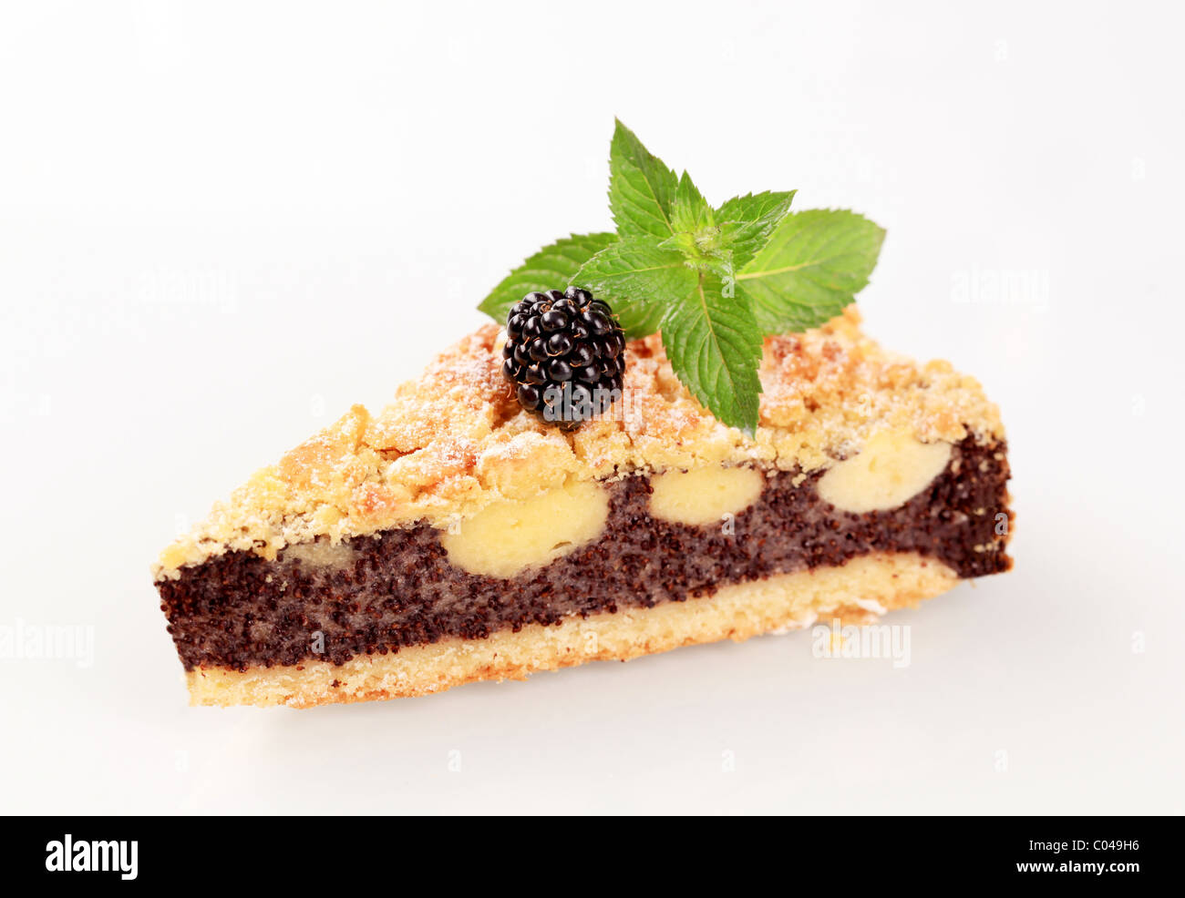 Slice of cake with crumb topping - Stock Image