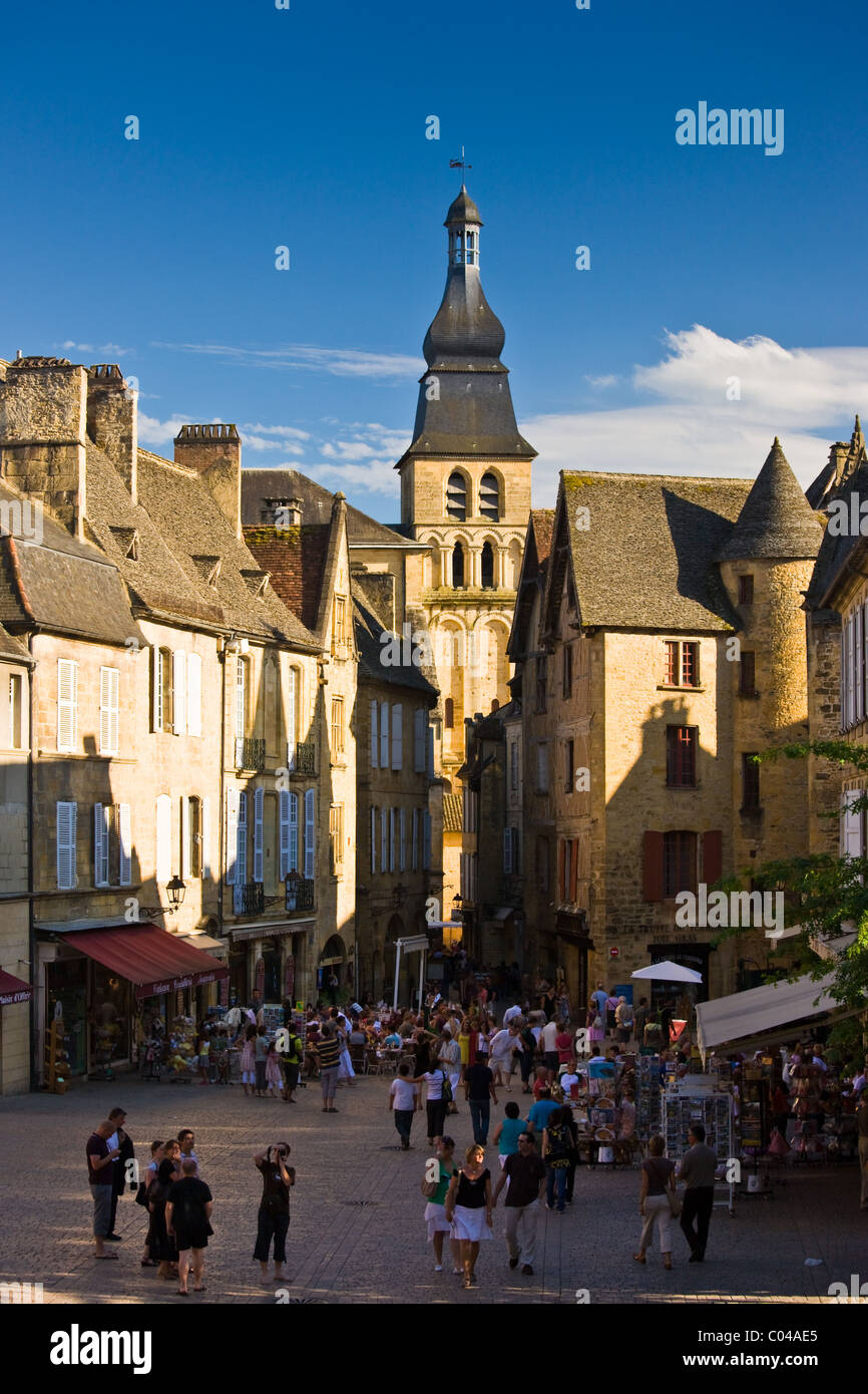 Centre Ville, tourists in town square of popular picturesque tourist destination of Sarlat in the Dordogne, France - Stock Image