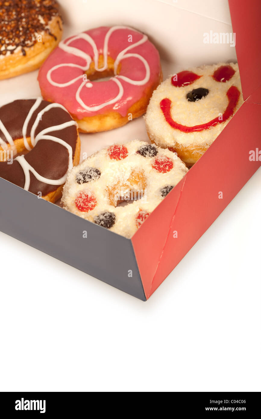some donuts in a box - Stock Image