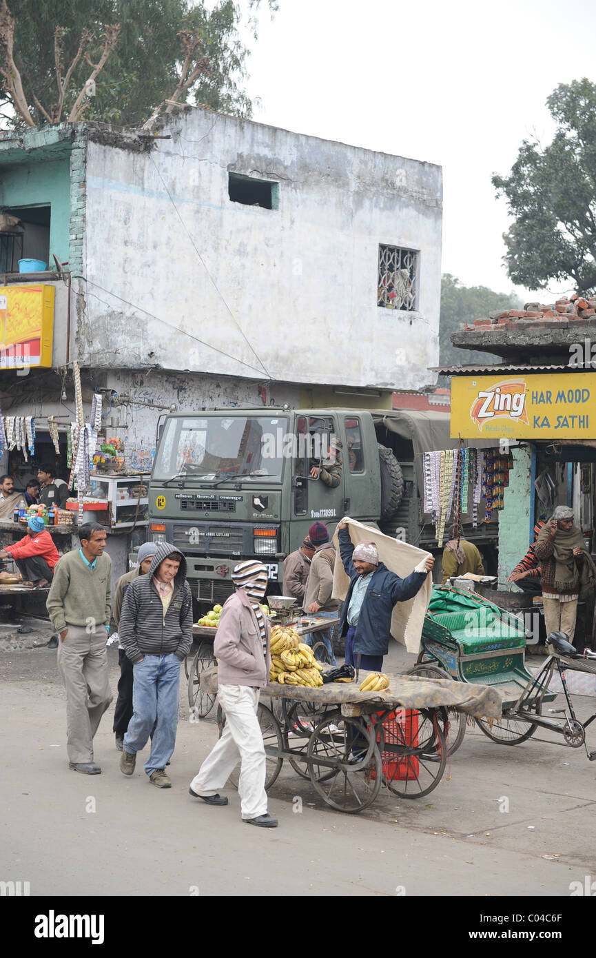 Street with people working in McLeod Gange, India - Stock Image