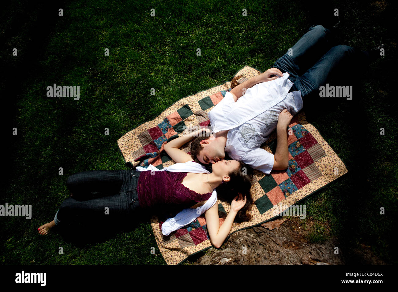 Couple Lying Down On Kiss Stock Photos Amp Couple Lying Down