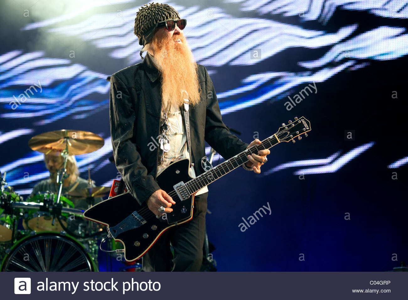 ZZ Top guitar singer and guitar player Billy Gibbons performing live - Stock Image