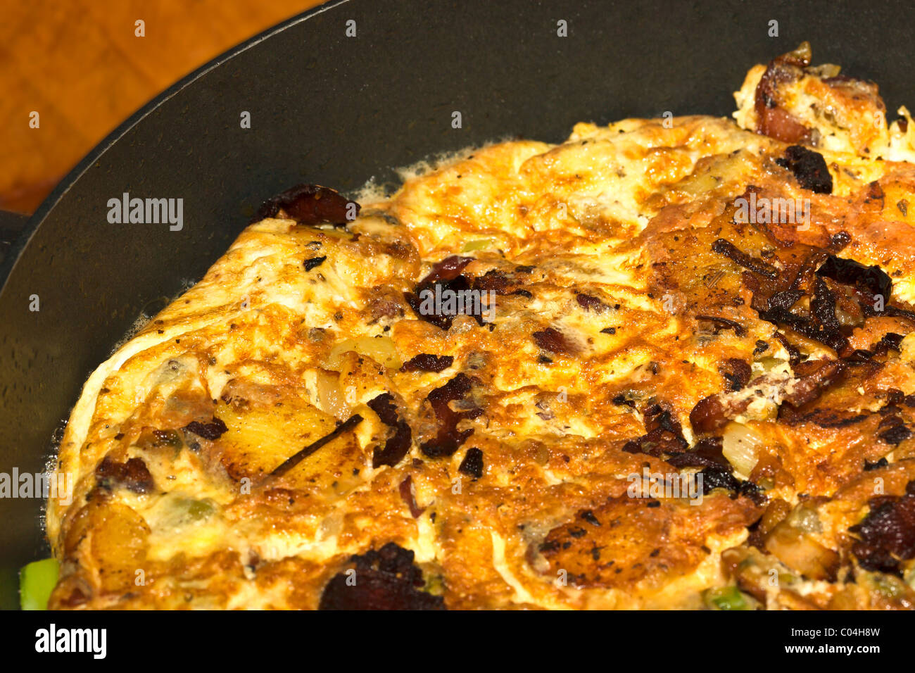 Fried asparagus, potato, and bacon frittata omelet. Charles Lupica - Stock Image