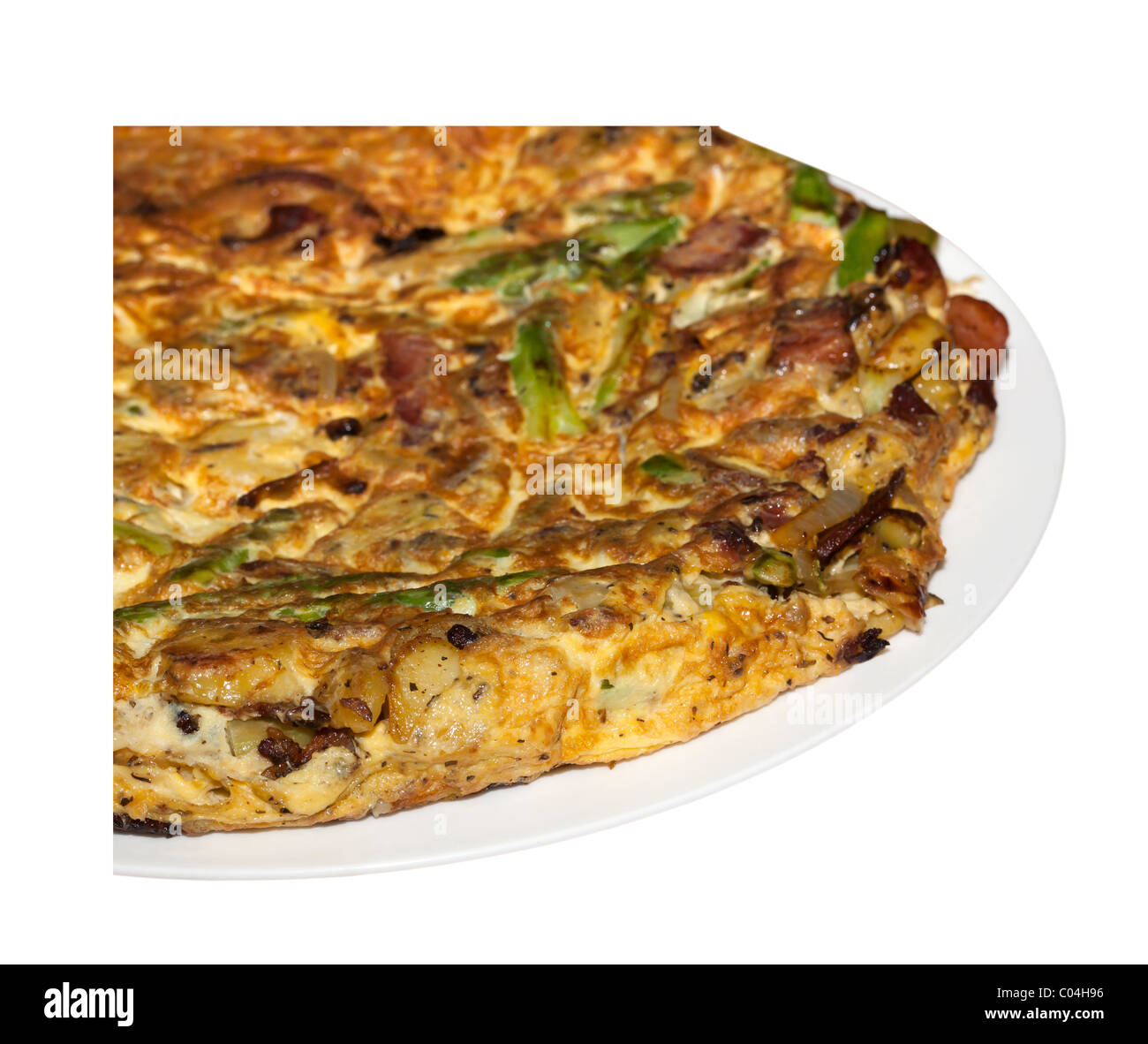Fried asparagus, potato, and bacon frittata omelet isolated on white. Charles Lupica - Stock Image