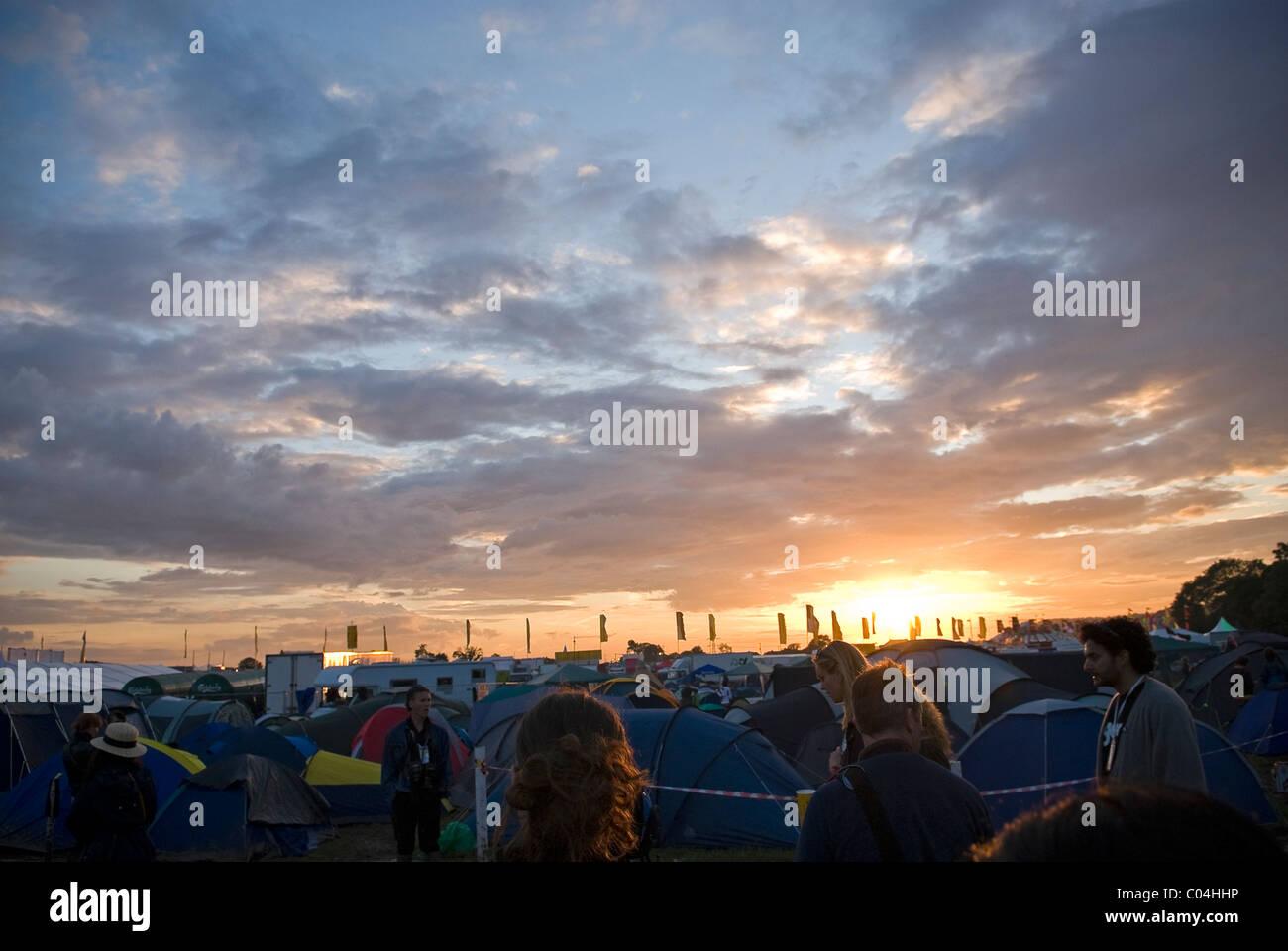 Beautiful sunset over the massed tents of Glastonbury Festival, Somerset, UK - Stock Image