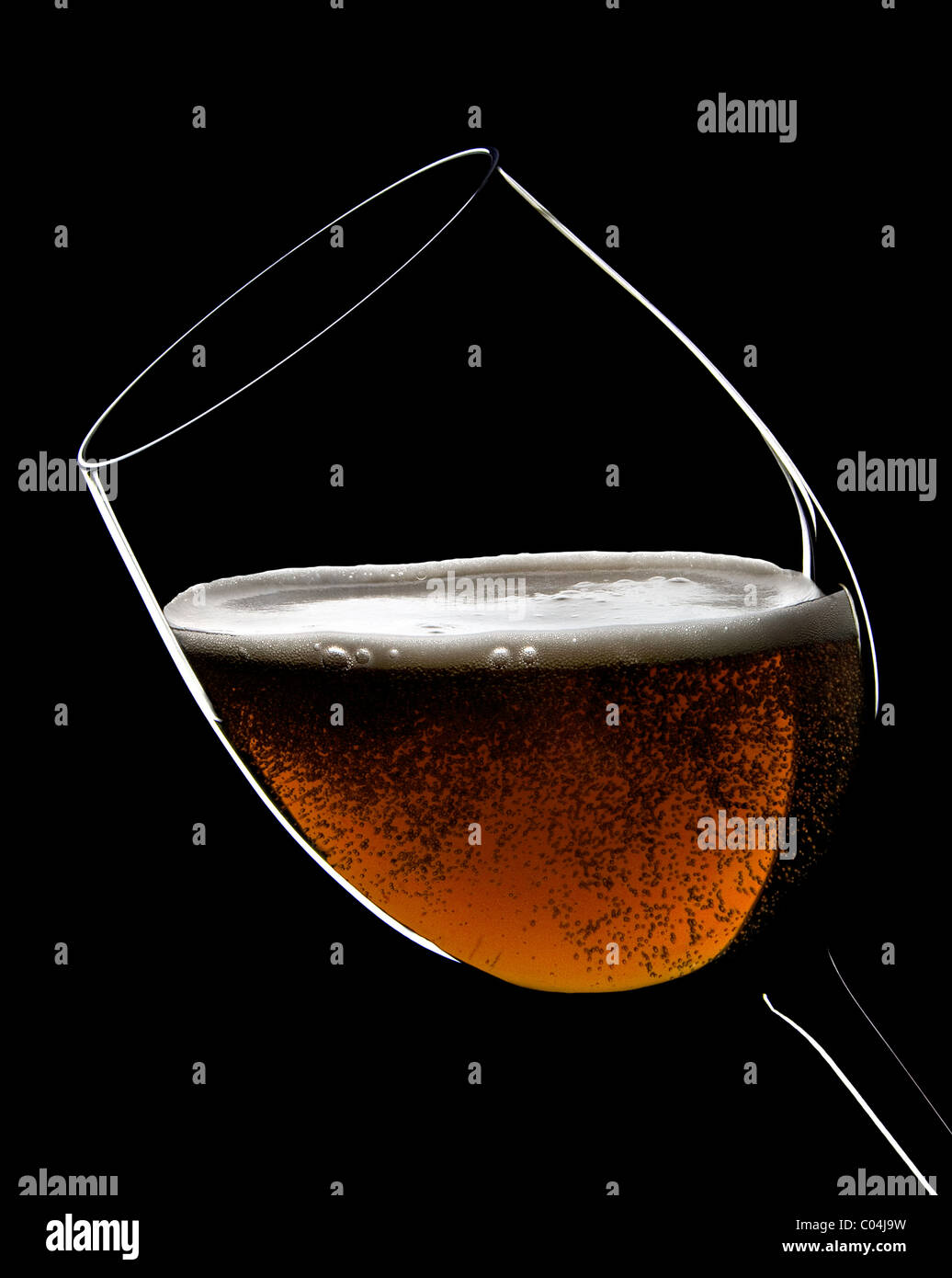 A big glasses full of beer with bubbles and foam Stock Photo
