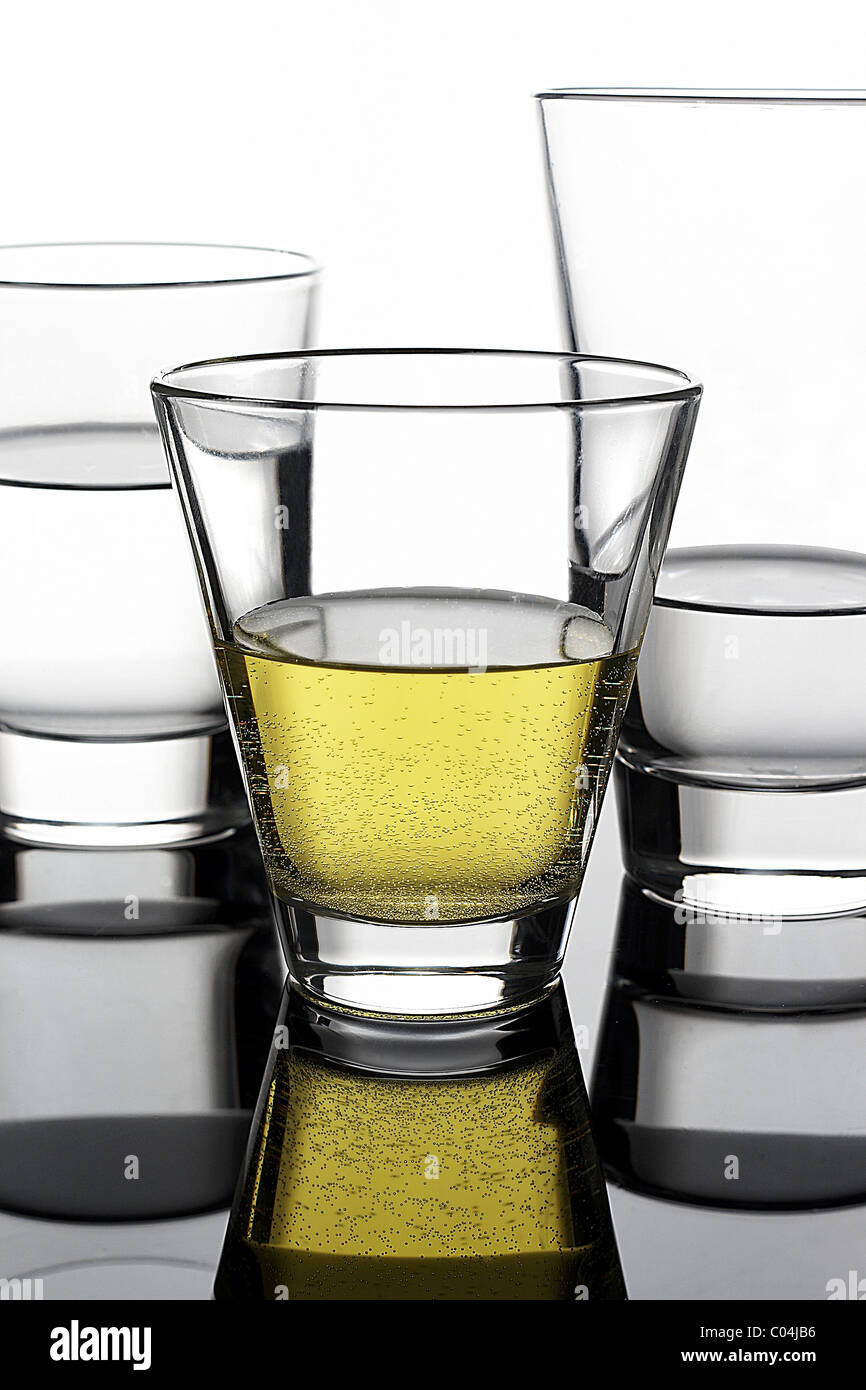 glasses with yellow liquid and reflection Stock Photo