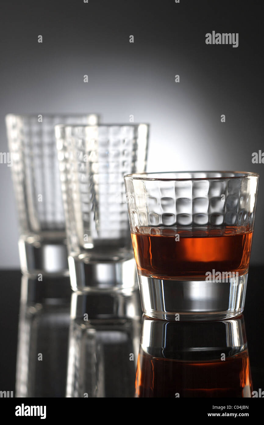 glasses with red drink and reflection Stock Photo