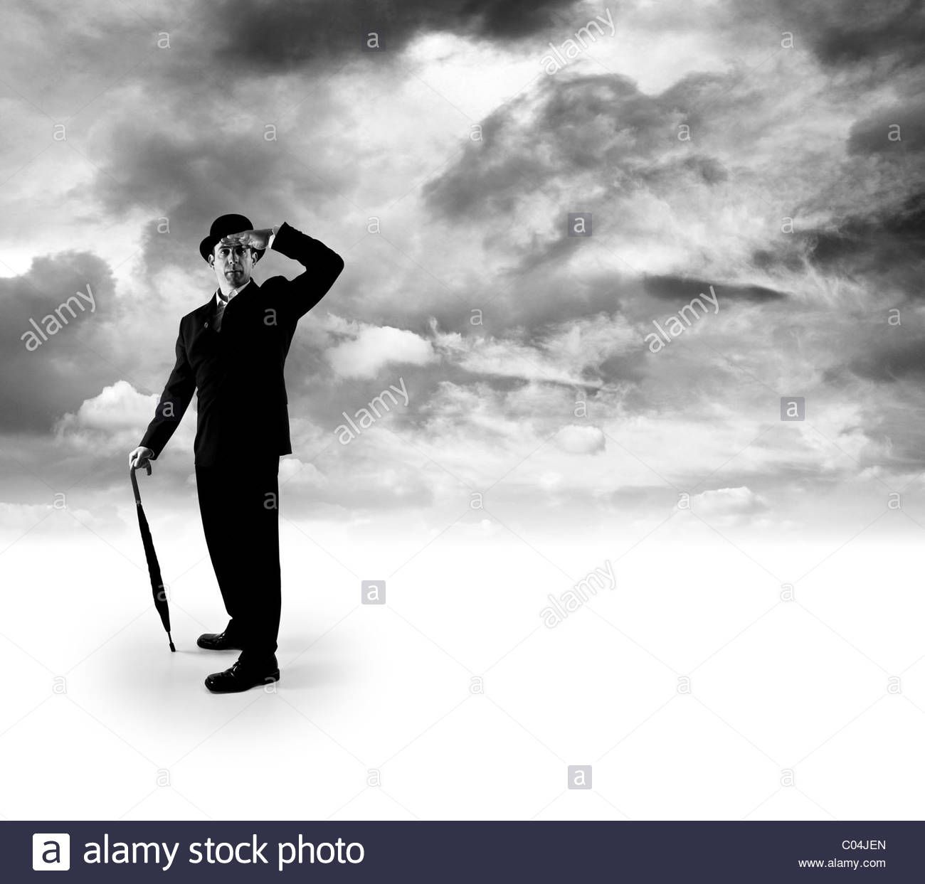 Businessman looking out - Stock Image