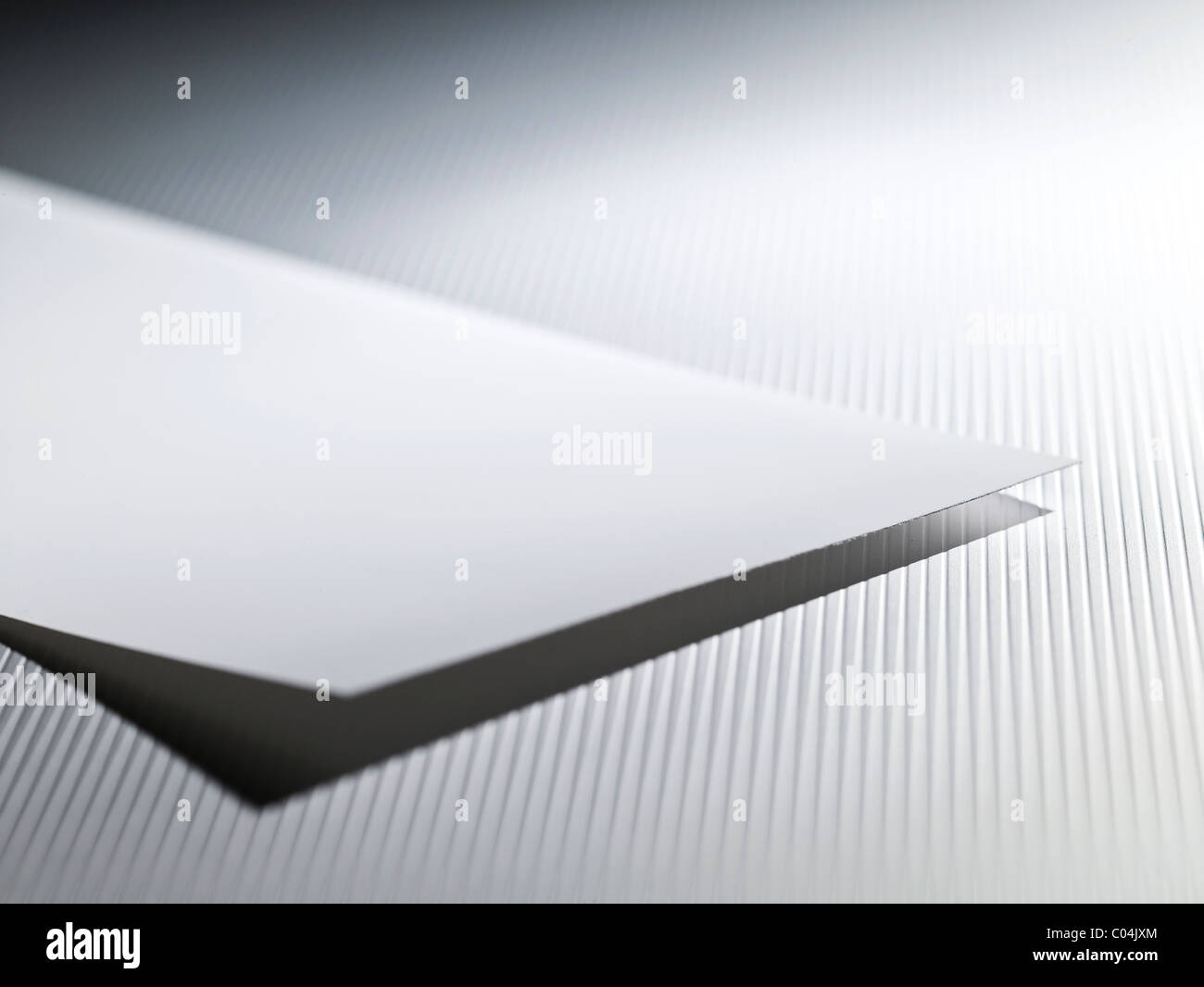 A paper on gray background - Stock Image