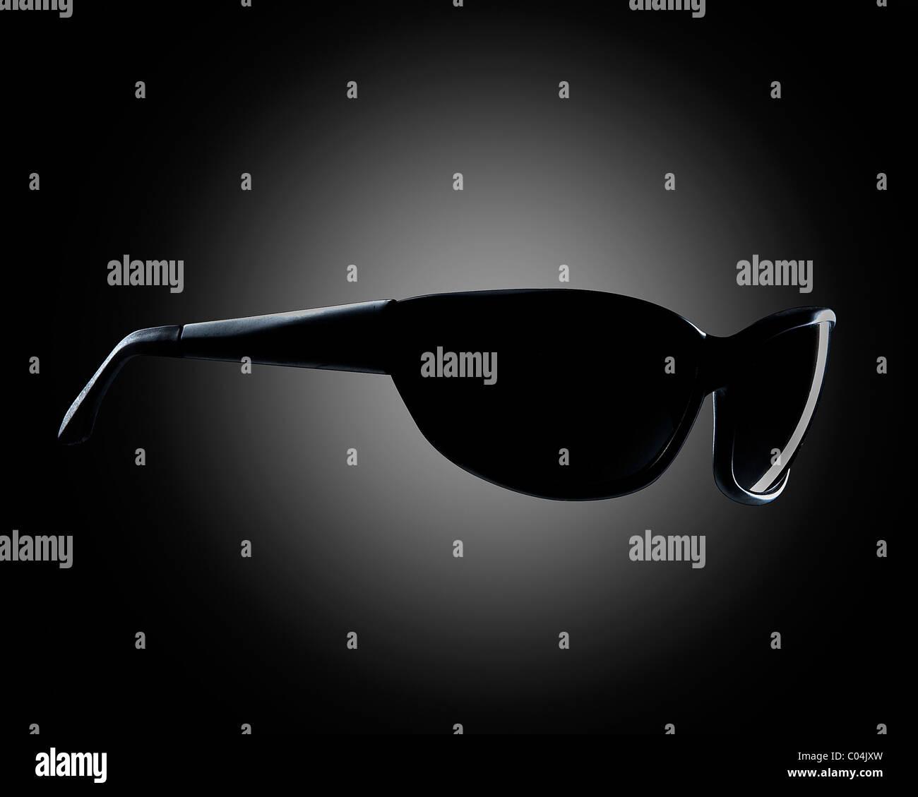 Black sunglasses on gray background Stock Photo
