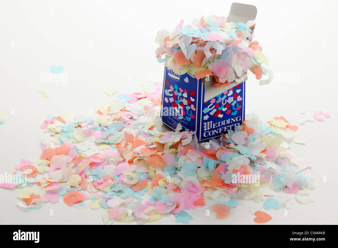 Pile of wedding confetti spilling from a box - Stock Image