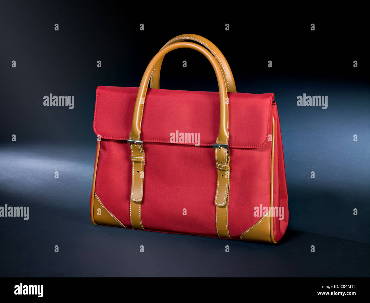Red canvas handbag with some parts made of leather Stock Photo
