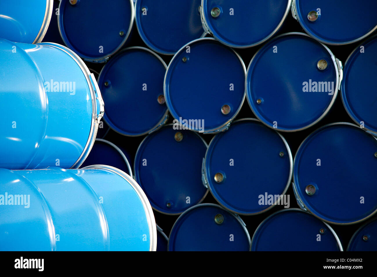 Blue barrels in the warehouse of a company - Stock Image