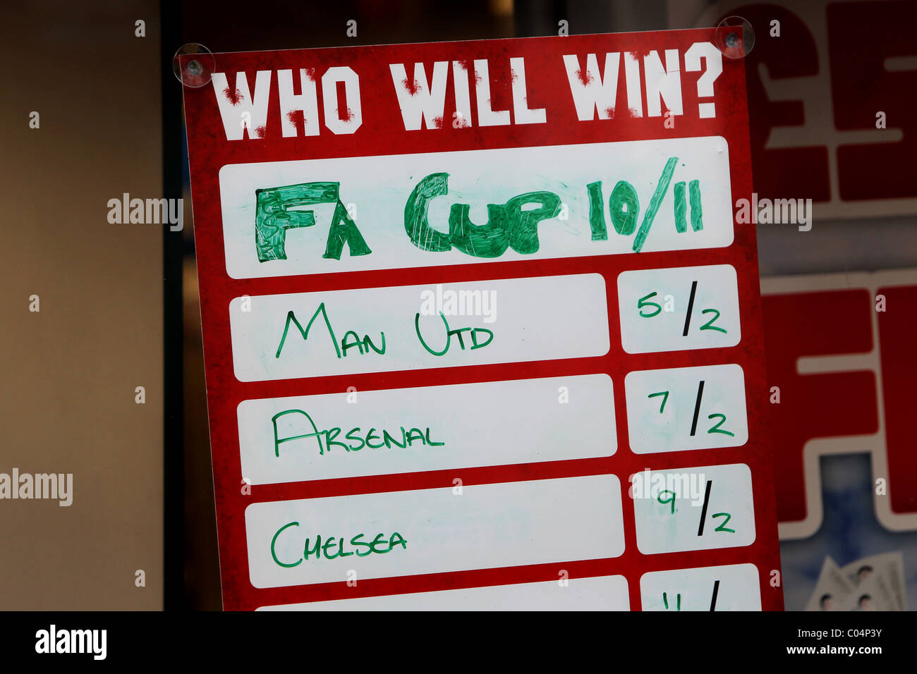 Betting shop window display promoting the odds on football teams to win the FA Cup in Brighton, East Sussex. - Stock Image