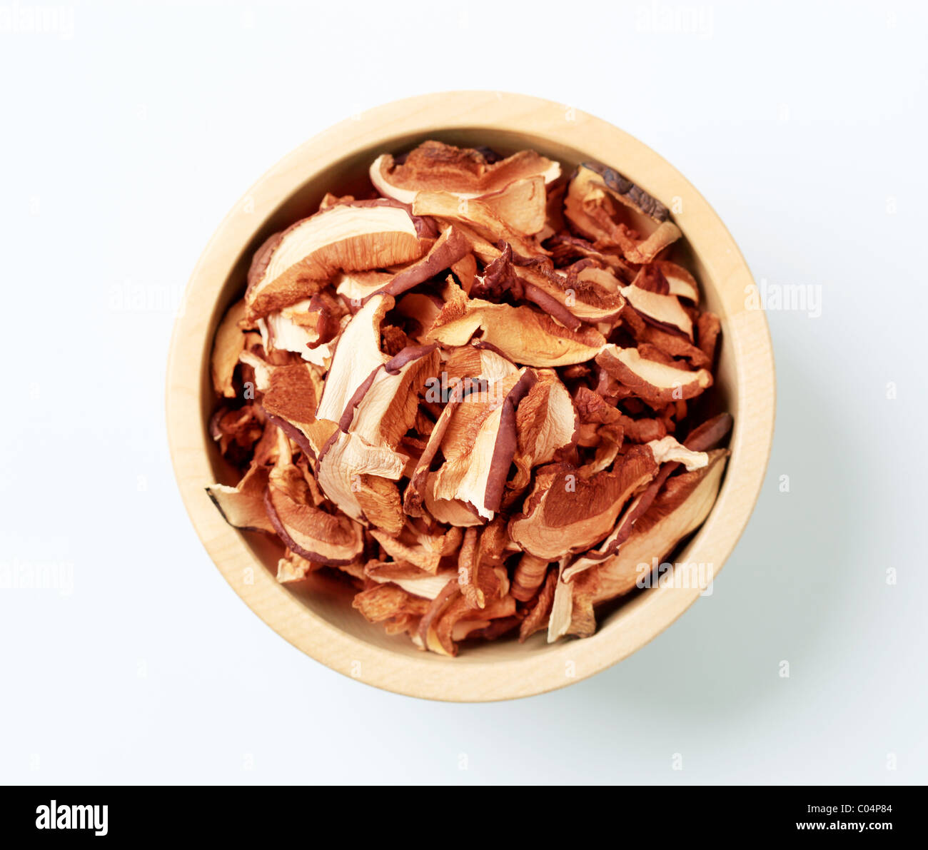 Bowl of dried mushrooms cut into slices - overhead - Stock Image