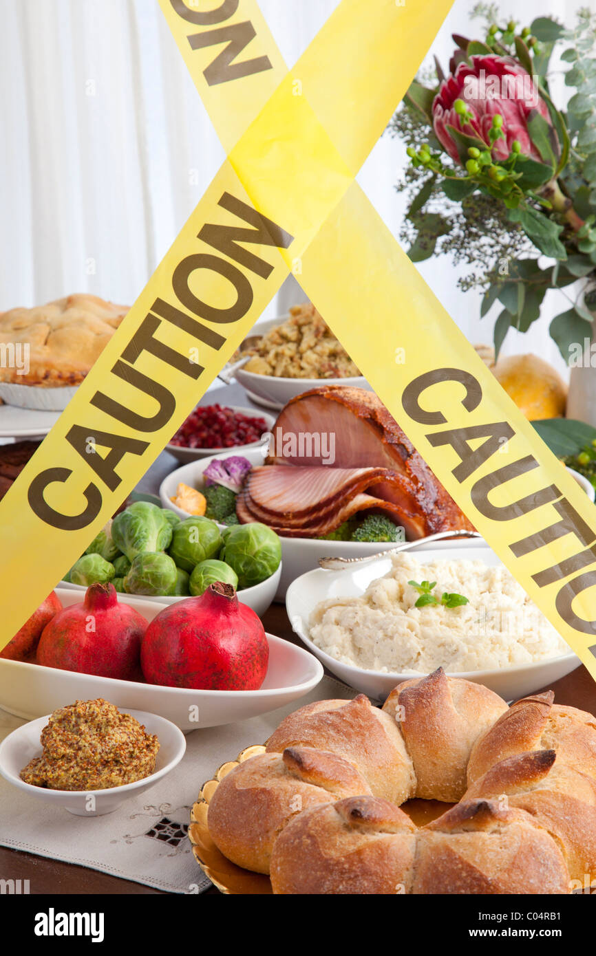 feast blocked by caution tape - Stock Image