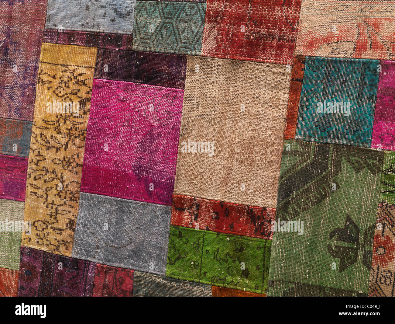 Carpet made of colorful patches of recycled vintage carpets - Stock Image