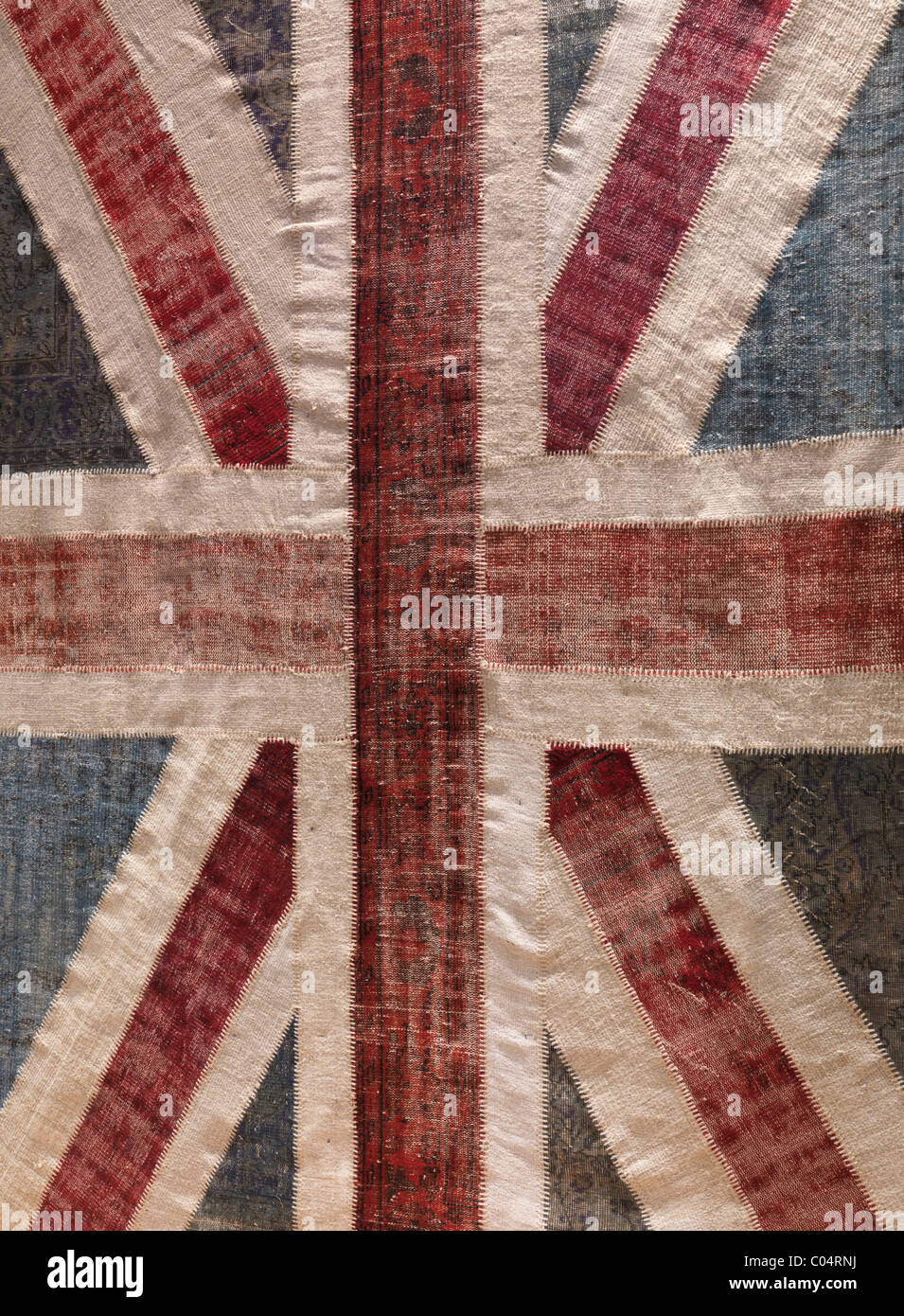 Carpet with Union Jack pattern made of colorful recycled vintage carpets - Stock Image
