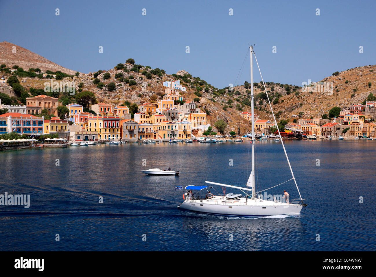 Greece, Symi island, Dodecanese. Partial view of Gyalos, capital and main port of the island. Stock Photo