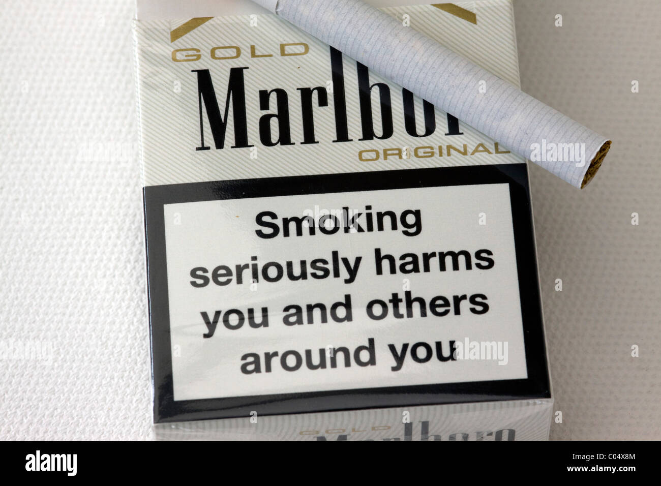 A Packet of Marlboro Cigarettes with warning on - Stock Image