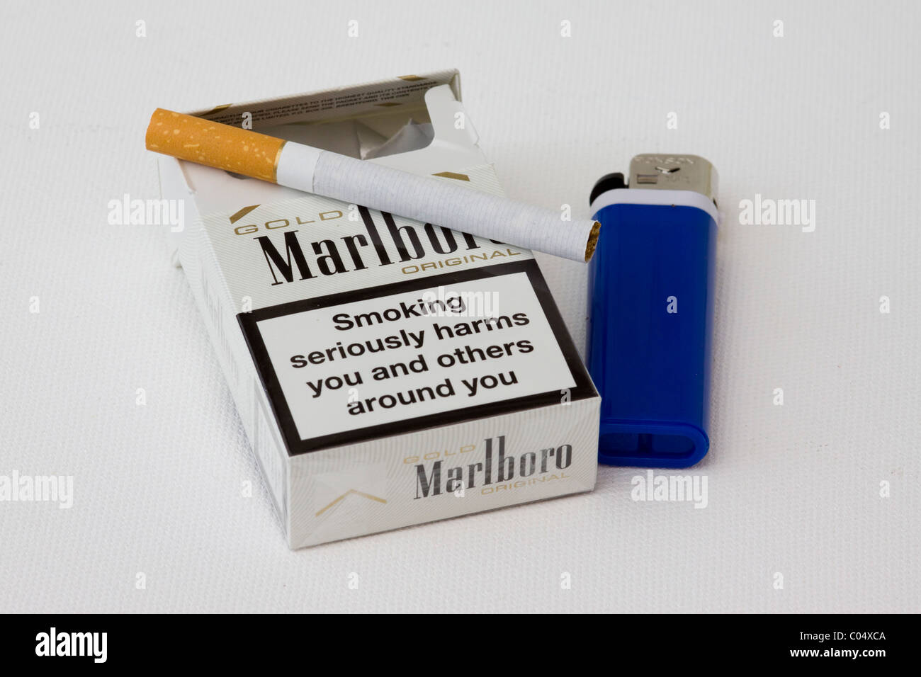 A Packet  Marlboro of Cigarettes and Lighter - Stock Image