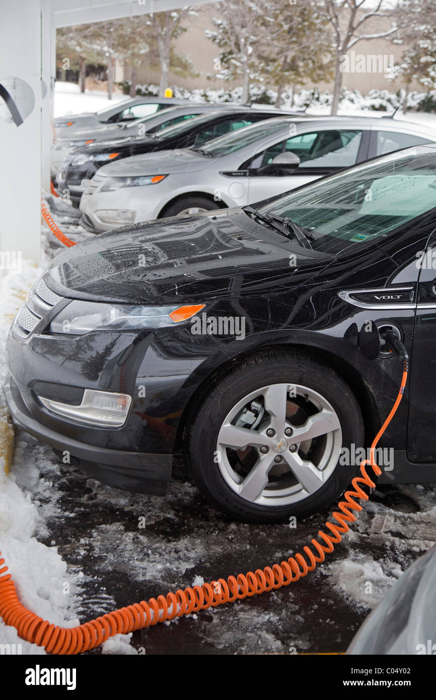 Chevrolet Volt Electric Cars Charging Outside the Factory Where They are Manufactured - Stock Image