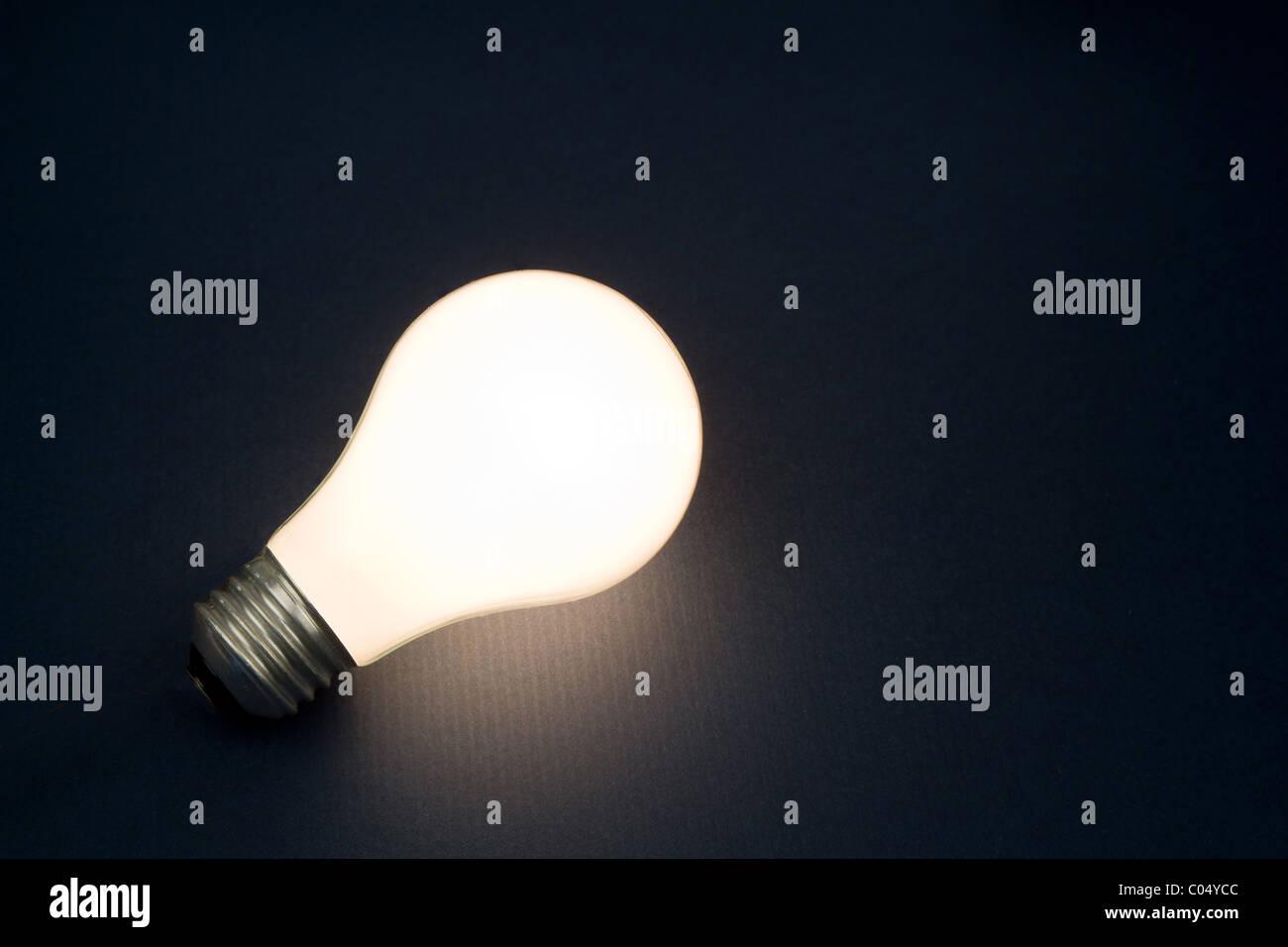 Bright Light Bulb close up shot - Stock Image
