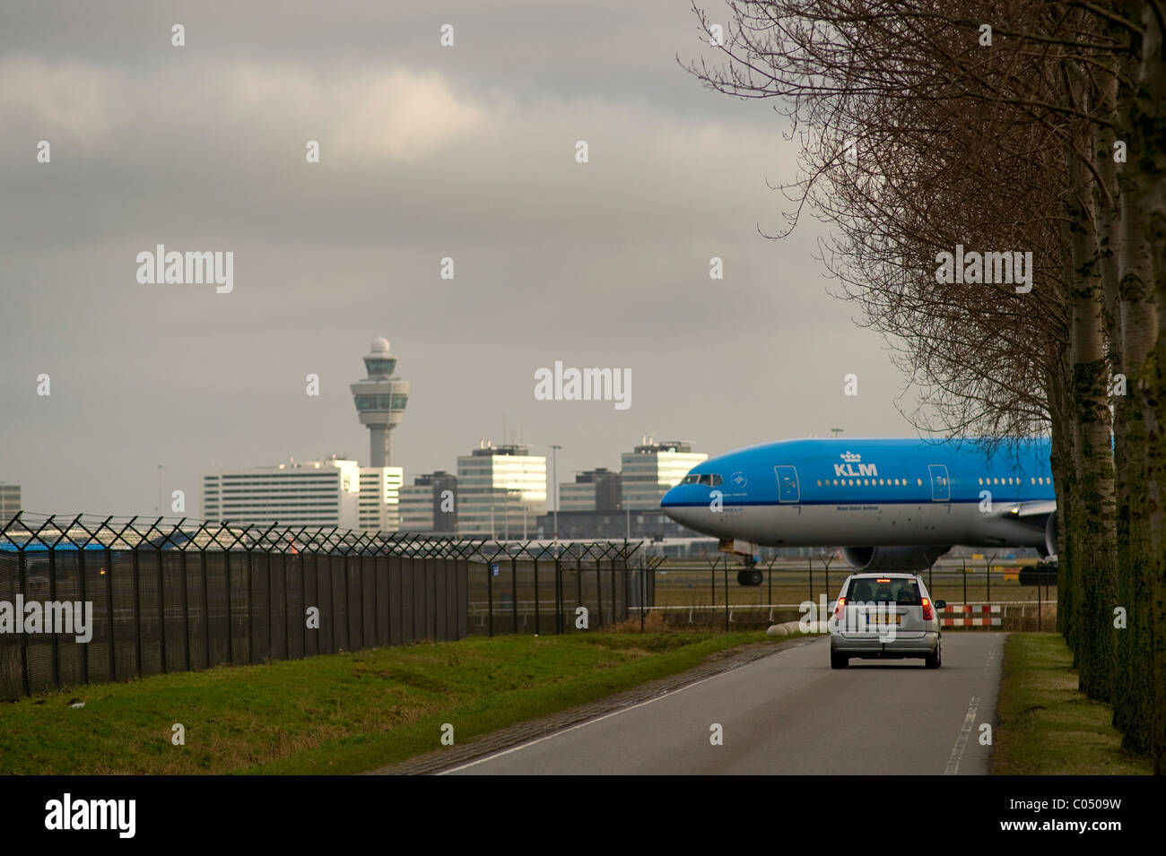 Airplane taxiing at Schiphol Airport Amsterdam - Stock Image