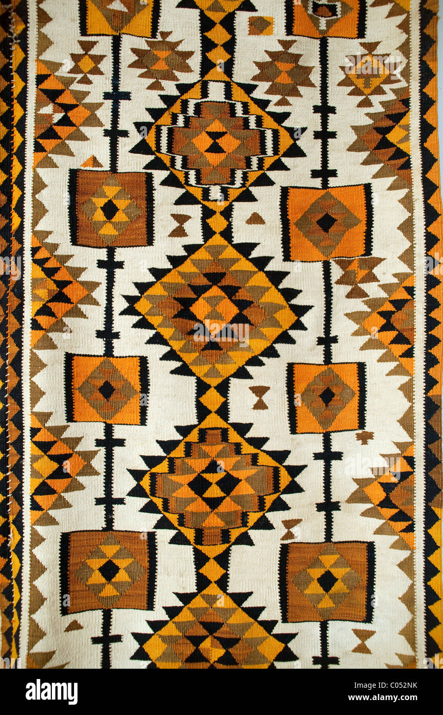 An early 20th century Kurdish tribal kilim hanging in the Kurdish Textiles Museum in the city of Erbil, in Northern - Stock Image