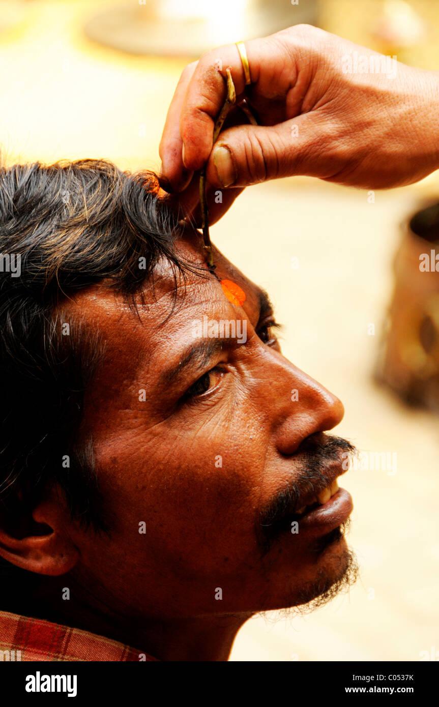 nepalese man during new year ritual, peoples lives ( the nepalis ) , life in kathmandu , kathmandu street life , - Stock Image