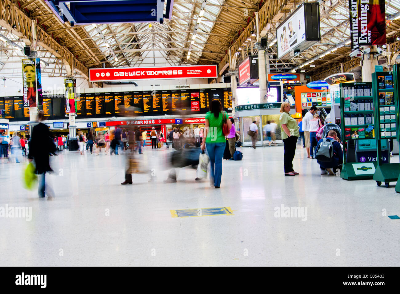 Interior of Victoria Station in London, England. - Stock Image