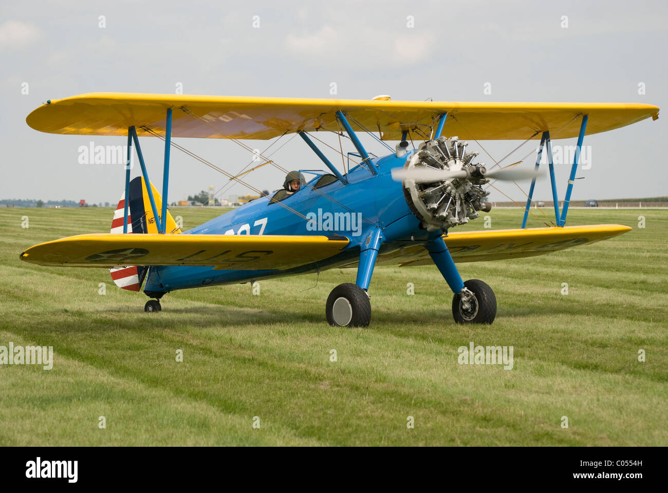 Biplane with radial engine - aircraft of type Boeing Stearman E75 on the ground, taxiing - Stock Image