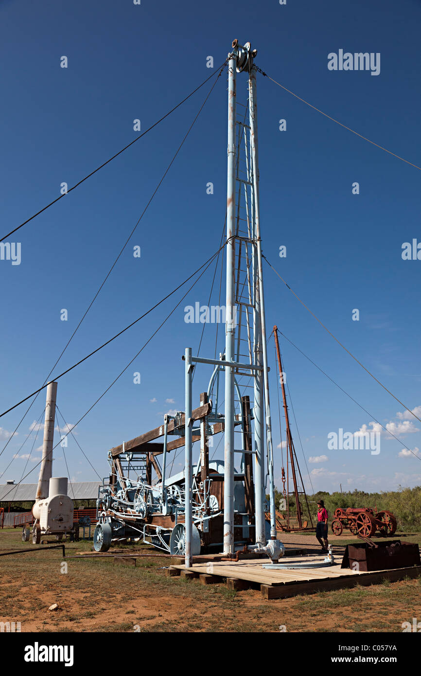 Person standing beside Star Spudder 45C drilling machine Permian Basin Petroleum Museum Midland Texas USA - Stock Image