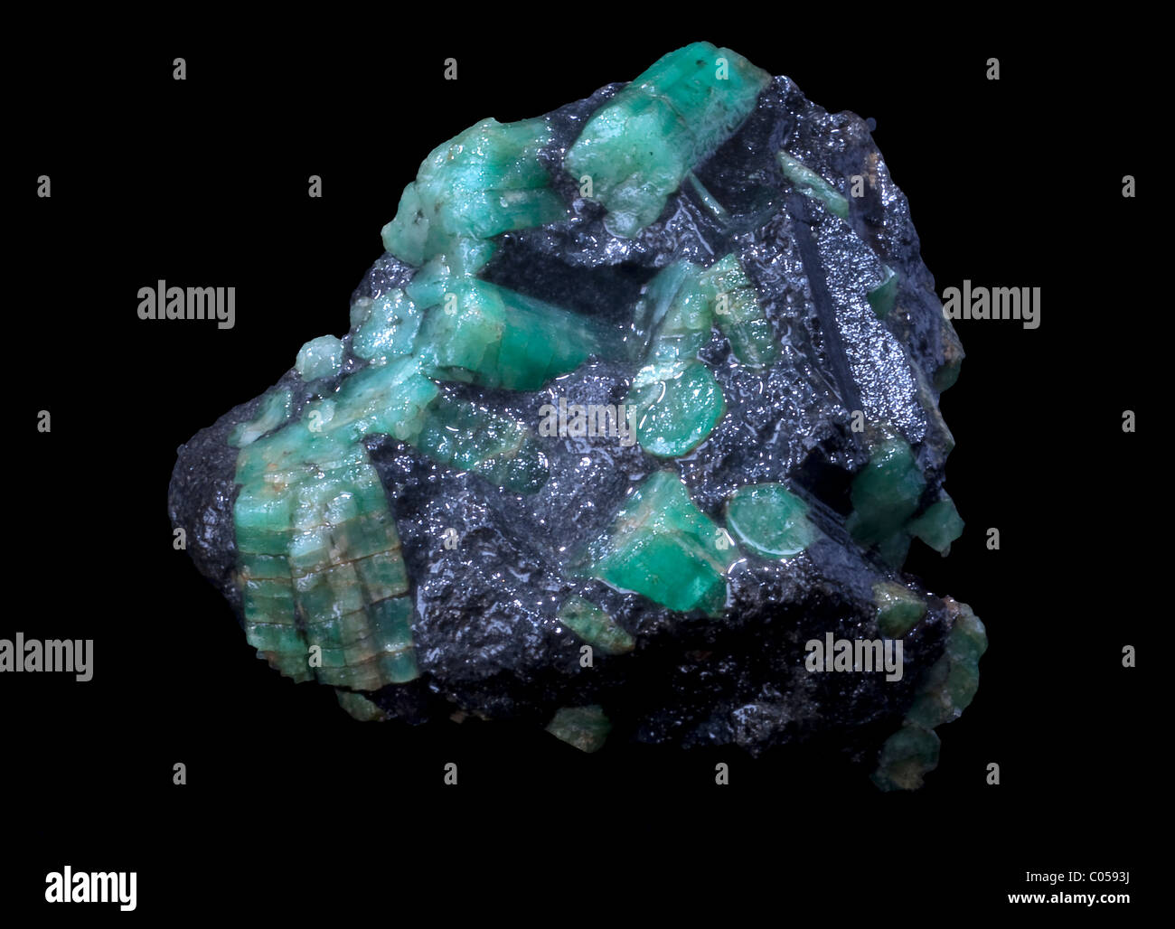 emerald stone in a black isolated background - Stock Image