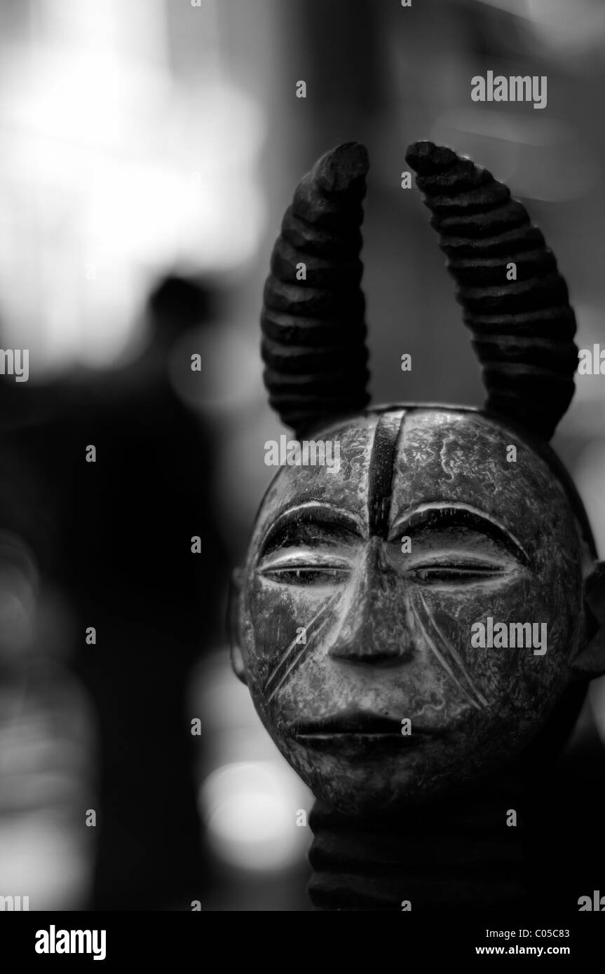 Madrid, Spain. African mask in public market - Stock Image