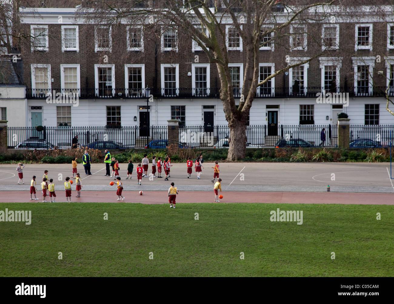 Schoolchildren playing in Duke of York Square, Chelsea, London - Stock Image