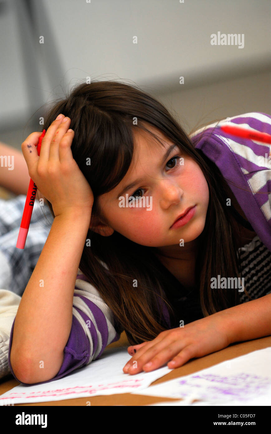 Young girl at a theatre workshop which aims to develop the creative skills of young people, London, UK. - Stock Image