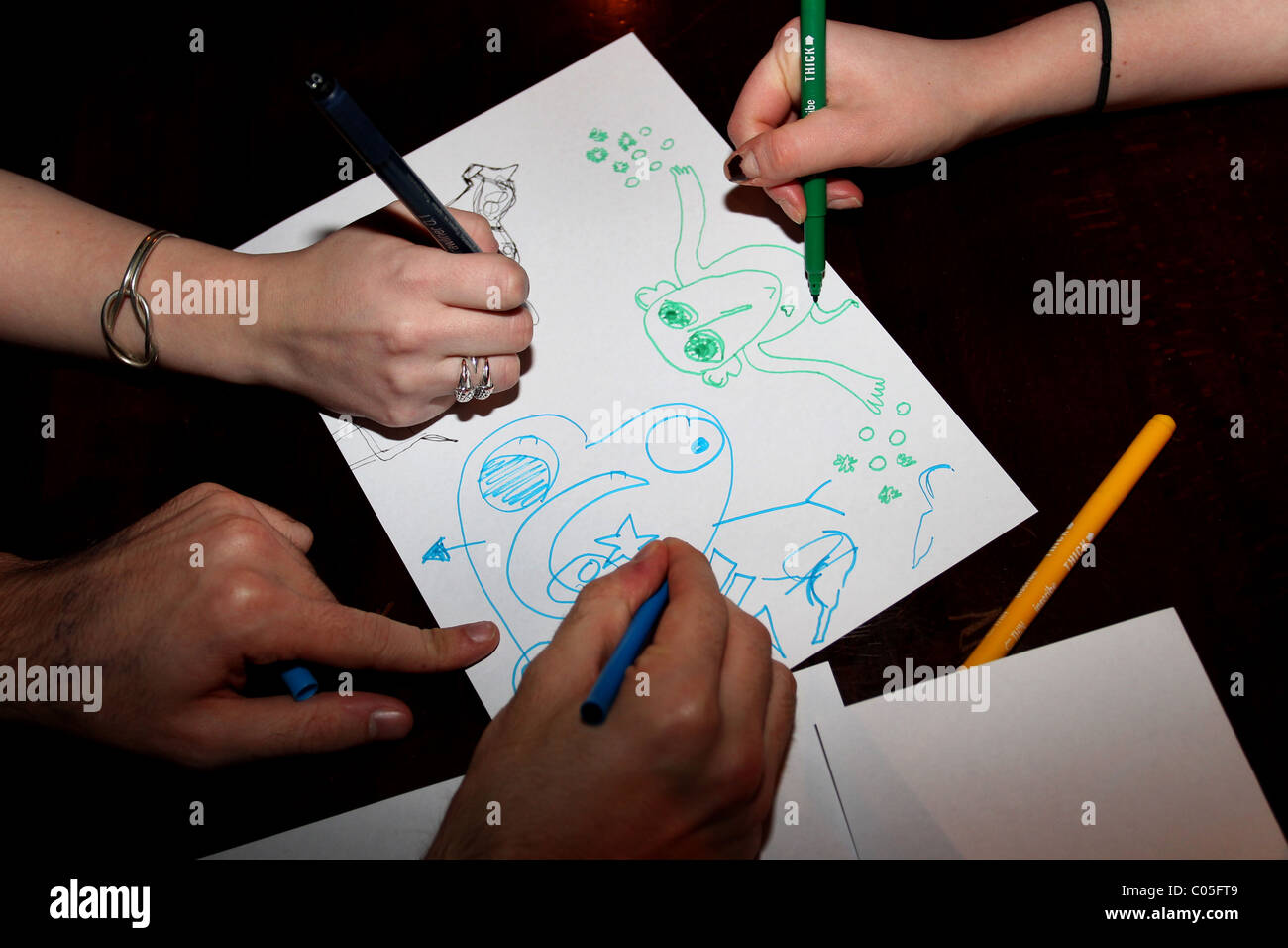 Three people pictured taking part in a Doodle Date, a new