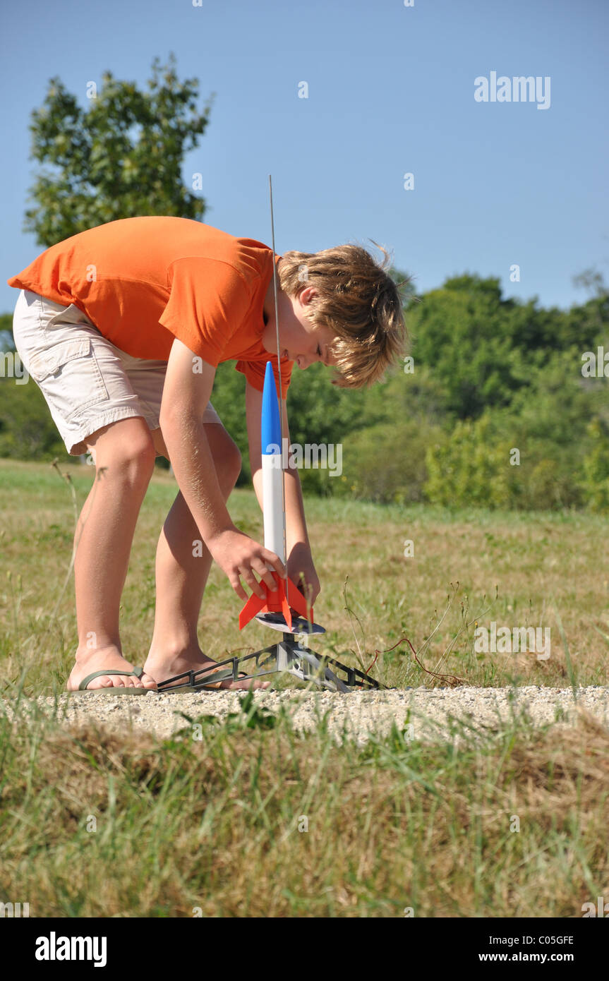 boy set up launch pad for model rocket - Stock Image