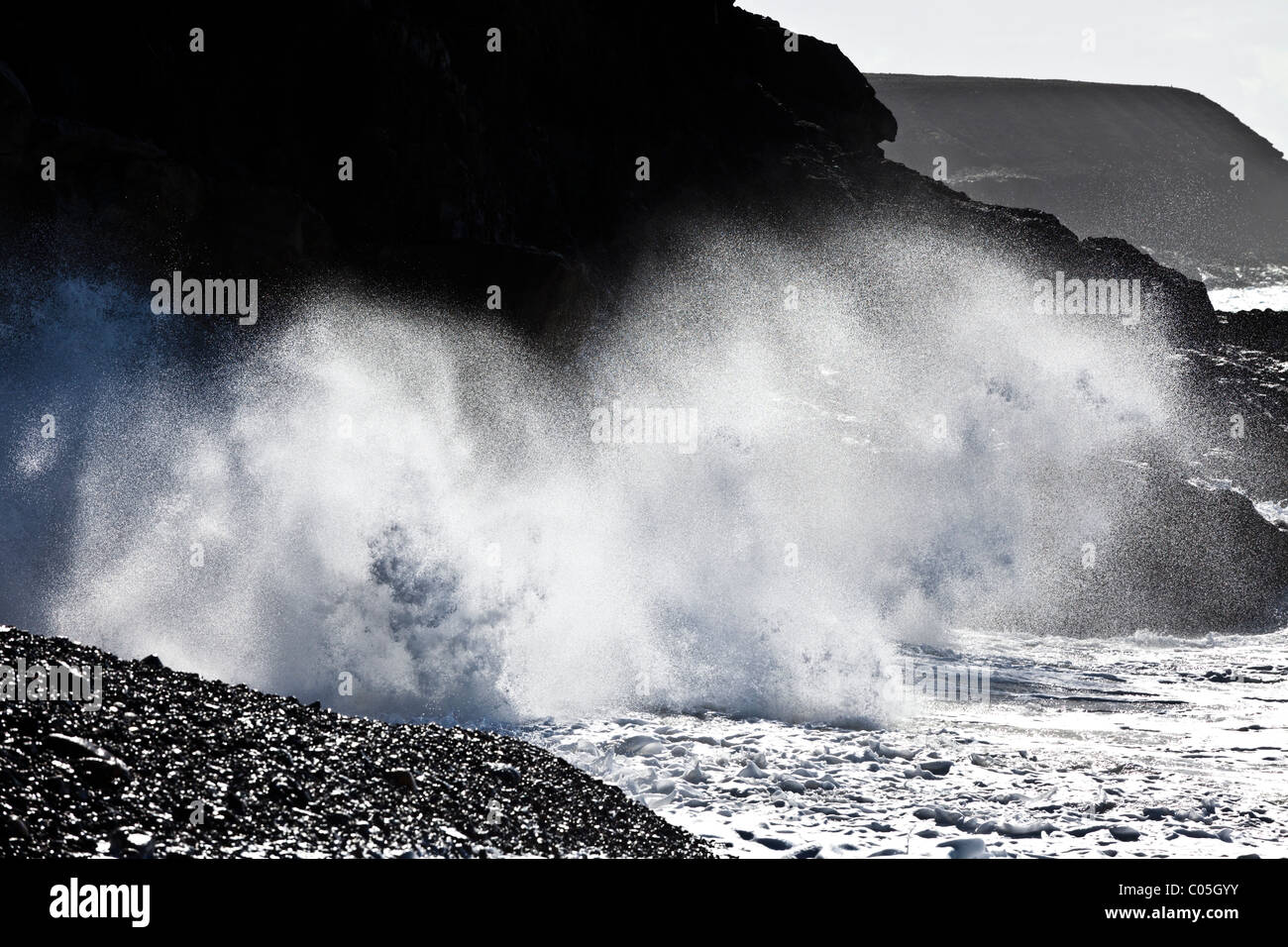 Heavy Atlantic seas with large waves crashing onto the beach at Ajuy on the Canary Island of Fuerteventura - Stock Image