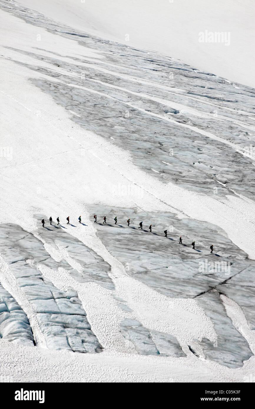 Hikers on Juklavassbreen, Folgefonna glacier, Western Norway - Stock Image