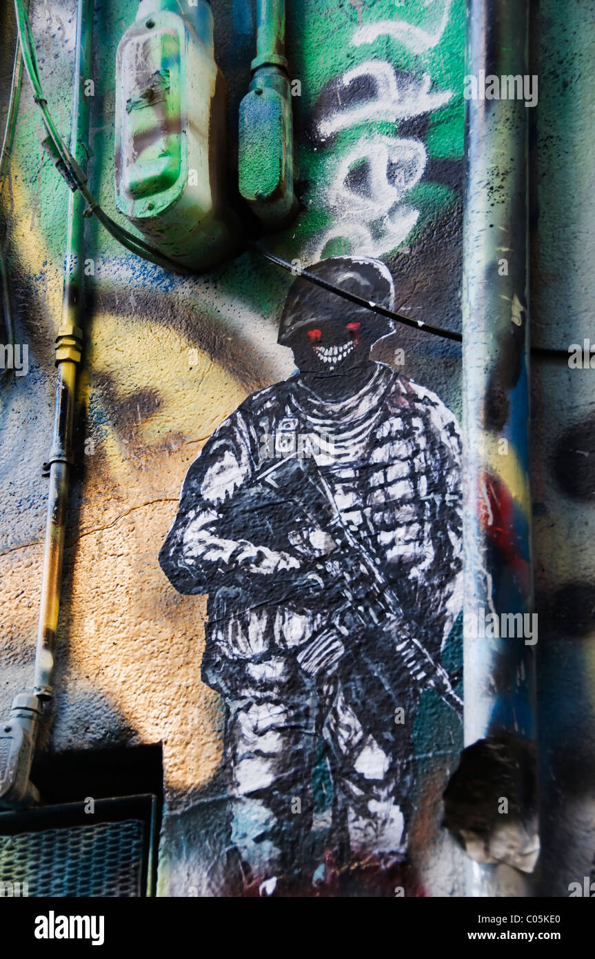 Graffiti figure on a portion of the Free Wall behind Olympia's Capitol Theater in downtown Olympia, Washington. - Stock Image