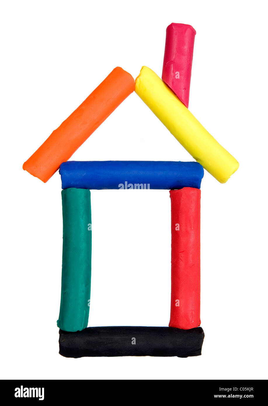 Funny house made from colorful plasticine, child playing concept - Stock Image