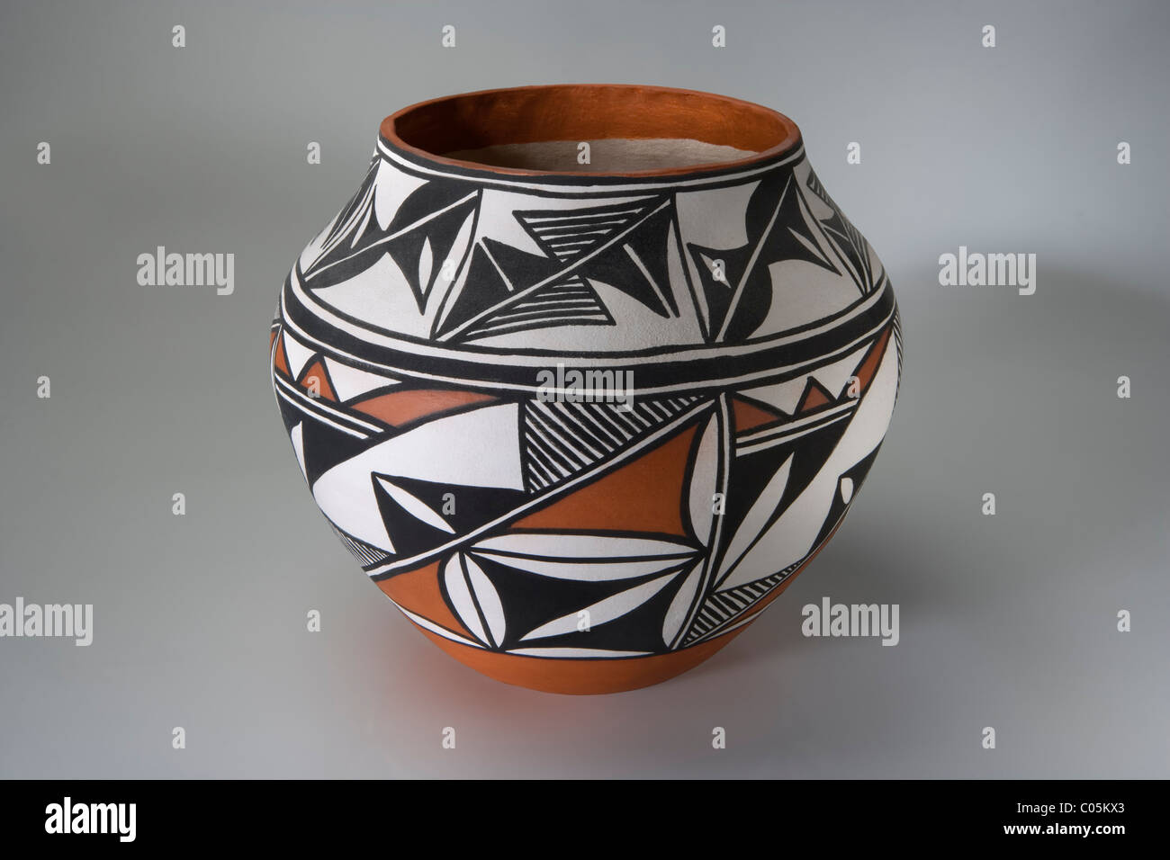 A hand coiled and painted Acoma pueblo Indian pot - Stock Image
