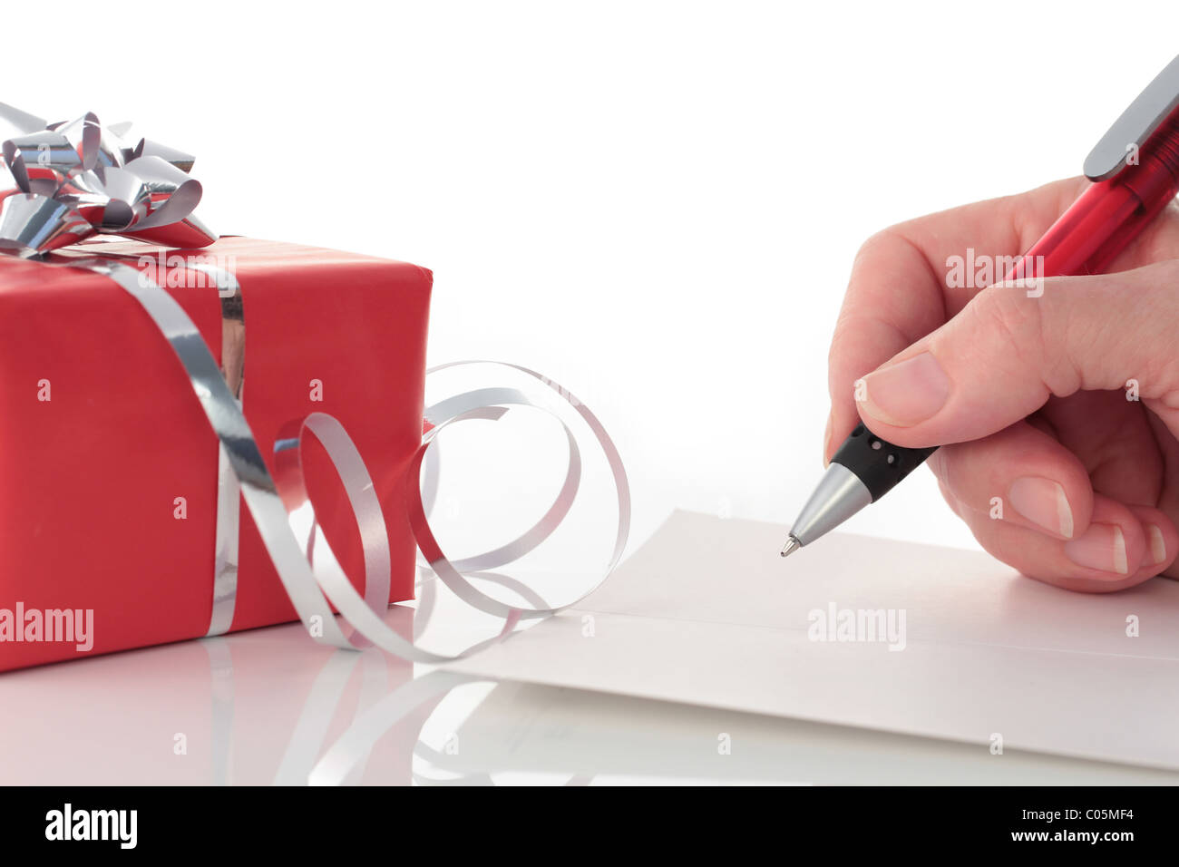 Hand Writing in Card by Red Valentines Day Gift - Stock Image
