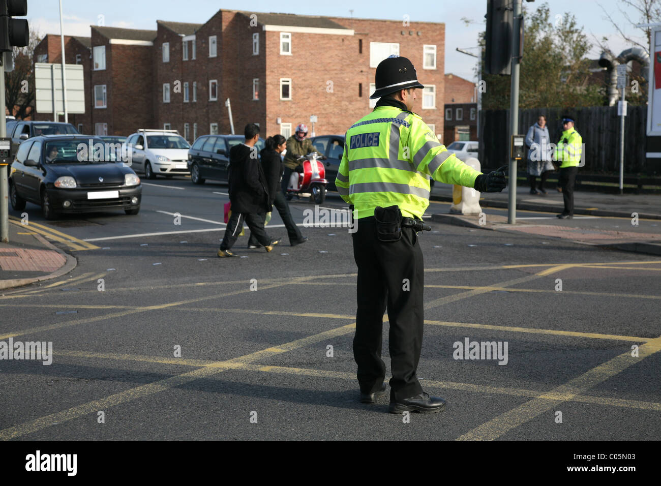 leicestershire police close road and direct traffic - Stock Image